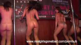 Four sexy girls strip naked on stage for a spring break wet t shirt contest